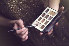 Vintage woman with makeup kit Royalty Free Stock Photos