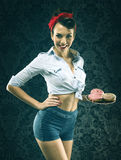 Vintage woman in old-fashioned dress, serve donuts Royalty Free Stock Photos