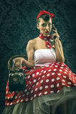 Vintage woman, in old room with dial phone Stock Photos