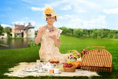 Vintage woman picnic by lake Royalty Free Stock Image