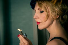 Vintage woman portrait with the lighter. Vintage woman portrait with lighter Royalty Free Stock Photo