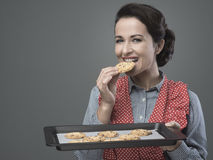 Vintage woman preparing homemade cookies Stock Images