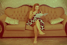Vintage woman reading Stock Photography