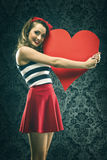 Vintage woman in red dress embraced big paper heart Royalty Free Stock Photography