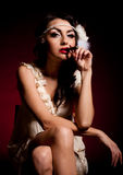Vintage woman in retro dress with cigar Royalty Free Stock Image
