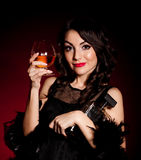 Vintage woman in retro dress with cognac Stock Images