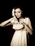 Vintage woman in retro dress with dollars Royalty Free Stock Photography