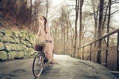 Vintage woman riding the bike Royalty Free Stock Photo