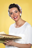 Vintage woman smiling and holding a book Royalty Free Stock Image