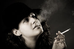 A vintage woman smoking a cigarette Royalty Free Stock Images