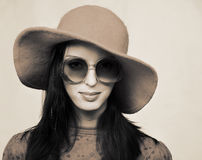 Vintage woman in sunglasses and red hat. Smooth portrait of young woman in sunglasses and red hat in retro style Royalty Free Stock Photo