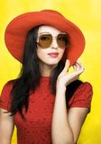 Vintage woman in sunglasses and red hat Stock Photo