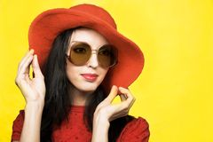 Vintage woman in sunglasses and red hat Stock Images