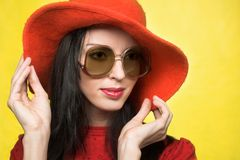 Vintage woman in sunglasses and red hat Royalty Free Stock Photos
