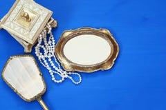 vintage woman toilet fashion objects next to blank frame Royalty Free Stock Photos