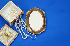 vintage woman toilet fashion objects next to blank frame Royalty Free Stock Photo