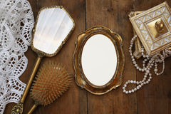 vintage woman toilet fashion objects next to blank frame Stock Image
