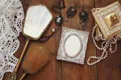 Free Vintage Woman Toilet Fashion Objects Next To Blank Photo Frame Stock Images - 80045054