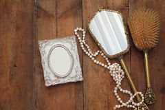 vintage woman toilet fashion objects next to blank photo frame Royalty Free Stock Photo