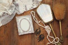 vintage woman toilet fashion objects next to blank photo frame Stock Photo