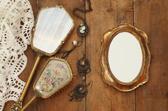 vintage woman toilet fashion objects next to blank photo frame Royalty Free Stock Images