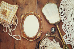 vintage woman toilet objects next to blank photo frame Royalty Free Stock Images