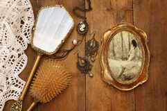 Vintage woman toilet objects next to old photography. Top view image of vintage woman toilet fashion objects next to photo frame with photography of beautiful royalty free stock photo