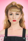 Vintage Woman. With victory roll curls hairstyle Royalty Free Stock Image