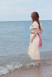 Vintage woman wadding in the sea Royalty Free Stock Images