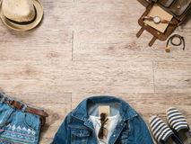 Vintage women clothing and accessories on the wooden background Stock Photos