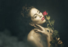 Vintage women with red rose Royalty Free Stock Images