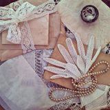 Vintage women's jewelry and gloves. Royalty Free Stock Photos