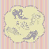 Vintage womens shoes. Graceful silhouette vintage womens shoes on Golden striped background Stock Photography