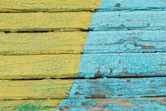 Vintage wood background with peeling  yellow and blue paint. Stock Photos