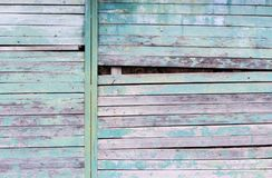 Vintage Wood Background With Peeling Turquoise Old Flaky Paint. Slanting Slit In The Wall Of A Large Barn Due To Skewed Boards. Stock Photos