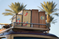 Vintage wood car with old travel suitcases. On roof rack Royalty Free Stock Photos