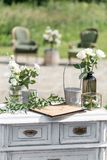 Vintage wood chairs and table with flower decoration in garden. outdoor.  stock images