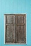 Vintage wood door on light blue wall Royalty Free Stock Photo