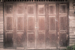 Vintage wood door of thai style house Royalty Free Stock Image