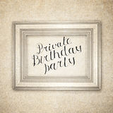Vintage wood frame  with handwritten text Private Birthday Party. Retro background Royalty Free Stock Photography