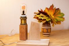 Vintage wood lamp with Edison bulb Stock Photography