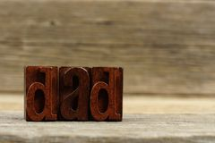 Vintage wood letters spelling DAD on a wood background Royalty Free Stock Photos
