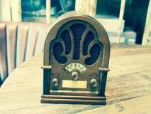Vintage wood radio. Retro vintage wood radio on wooden table Stock Photo