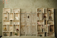Vintage wood shelf with books cage dry flowers. Vintage wood shelf with books cage royalty free stock image