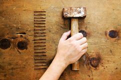 Vintage wood table with hammer and nails. Royalty Free Stock Image