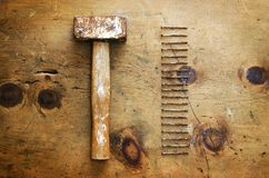 Vintage wood table with hammer and nails Stock Images