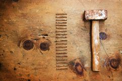 Vintage wood table with hammer and nails Royalty Free Stock Image