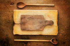 Vintage wood table with rustic kitchenware Royalty Free Stock Image