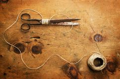 Vintage wood table with thread and scissor Royalty Free Stock Image