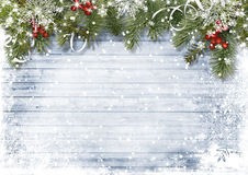 Vintage wood texture with snow, holly and firtree Royalty Free Stock Photos